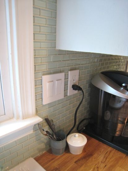 Electrical Outlet and Light Switches by Sink