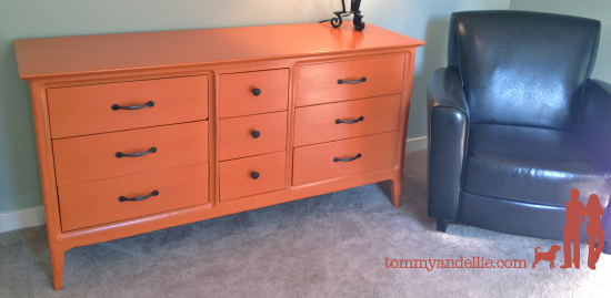 Repainted old dresser Orange for a boy's nursery. www.tommyandellie.com