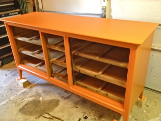Final coat of orange paint on dresser. www.tommyandellie.com