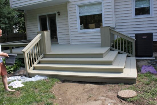 The stairs and deck painted with one coat of DeckOver